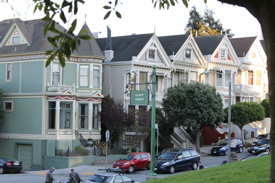 Alamo Square is known for four Victorian style homes fronting the San Francisco skyline.